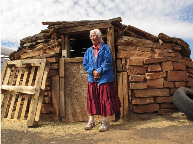 Navajo elder Stella Peshlakai Smith, 89, stands outside a traditional dwelling on her homestead at Wupatki National Monument in northern Arizona. The National Park Service, which manages the monument, and the Peshlakai family are at odds over the family's pursuit of residency in the vast expanse of grassland and pueblo ruins.