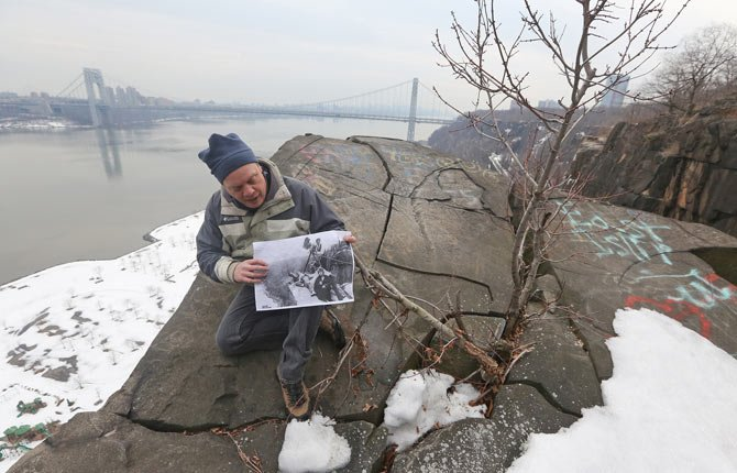 "Eric Nelsen, historic interpreter for the Palisades Interstate Park, sits for a photo on Cliffhanger Point holding a photo of silent movie star Pearl White as she was photographed on the same spot in 1918 for the film, ""House of Hate"" in Fort Lee, N.J., March 2. The Fort Lee Film Commission celebrated the birthday of Pearl White, star of the ""Perils of Pauline "" serial movie series. It was the 100th anniversary of the series that was filmed in Fort Lee."