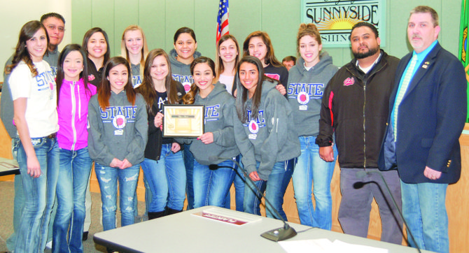 The Sunnyside High School girls basketball team was presented with a Mayor's Award by Jim Restucci (far right) at Monday night's Sunnyside City Council meeting. The team earned a trip to the State tourney this year and placed fourth in the competition.