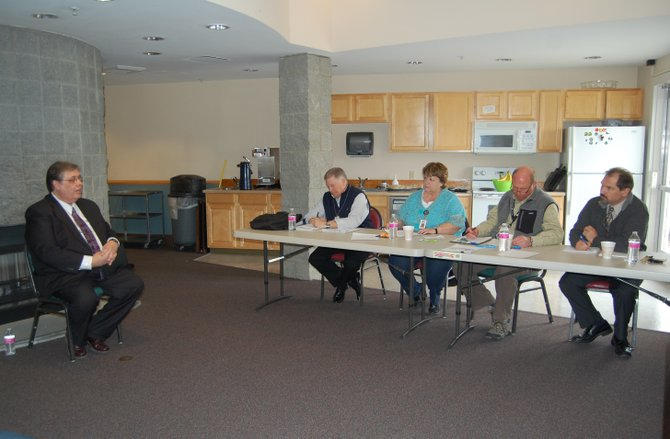 Three Rivers Hospital commissioners interview Coulee Medical Center CEO Scott Graham on Tuesday morning.