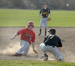 Clearwater Valley's Dillon Fisher beat Highland's attempt to make a play at third base with a strong slide last Monday, March 25, at CVHS. The Rams wound up winning 6-5; having lost to Prairie, they're 2-1.