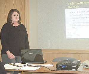Civil engineer Stephanie J. Ray presents an overview of the Sunnyside Municipal Airport funding opportunities and its master plan to the Sunnyside Municipal Airport Advisory Board, which met last night.