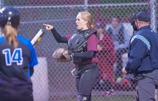 The Dalles catcher Morgan Goslin communicates with her pitcher during Tuesday nights game with Gresham.