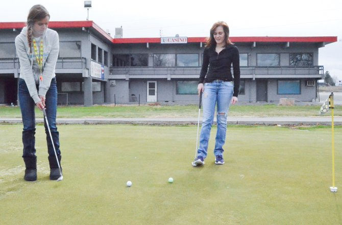 The Grandview High School girls golf team was scheduled for a match against Prosser yesterday (Wednesday), but it was canceled and rescheduled. Lady 'Hounds Hannah Pond and Reagan Colson (L-R) took advantage of the break in the schedule to practice their putting skills at Black Rock Creek Golf Course.