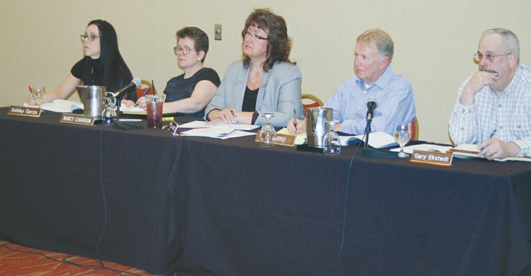 Yakima County Planning Commission members (L-R) Ashley Garza, Nancy Charron, Zella West, Ed Burns and Gary Ekstedt listen to testimony at Wednesday night's public hearing on the county's proposed ban on the production, processing and retailing of marijuana.