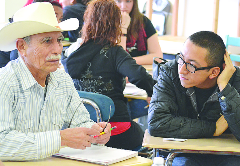 Felix Martinez (L), a student in Nuestra Casa's ESL class, visits with Felix Paniagua from Oregon State University yesterday during a cultural exchange.