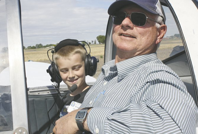 Young Eagle Michael Griffith gets ready to fly with pilot Jerry Kollmar during the 2013 Prosser Young Eagles event. Children ages 8 to 17 are welcome to schedule a free flight during this year's event to be held Saturday, May 17, from 8 a.m. to noon.