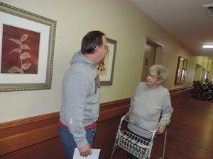 On her daily walk through the halls, Dean greets friend Tim Pullen, maintenance supervisor.