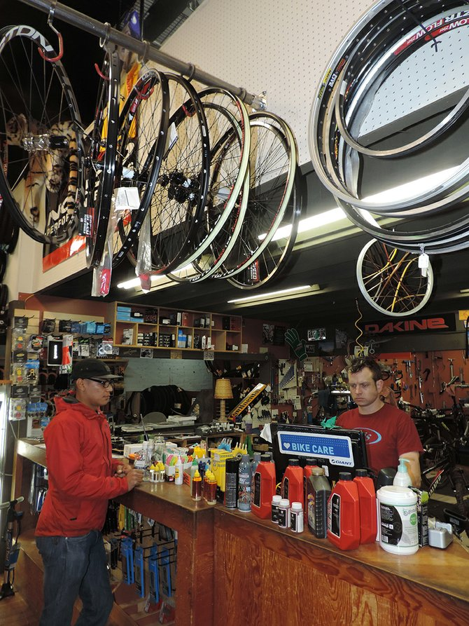 discover bicycles, at the epicenter of the State Street construction work, has felt the brunt of the work's effects. Owner Kurt Buddendeck, pictured Thursday with customer Isidro Bello, says business is way down this year because of the project.