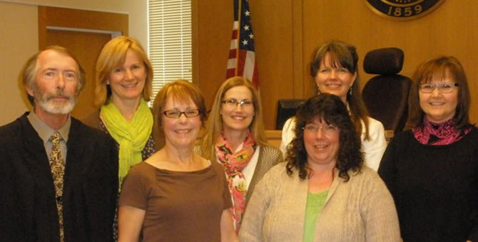 JUDGE PAUL CROWLEY welcomes new volunteers to the Columbia Gorge CASA, from left, Lisa Kidd, Norma Cordry, Zipporah Underhill, Rhonday Morrow, Crystal Dickenson and Michelle Mayfield.	Contributed photo