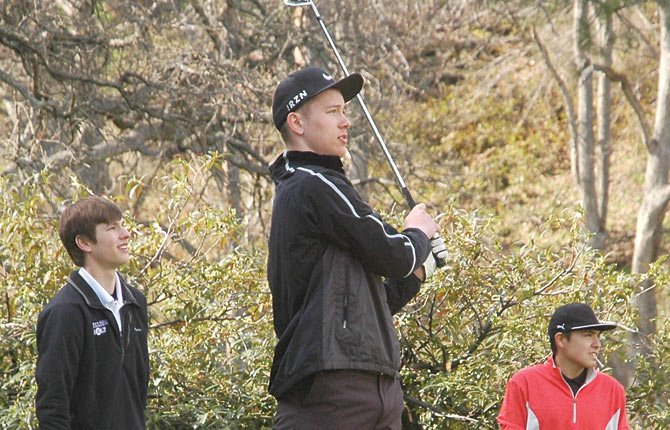 The Dalles golfer Coby Conlee watches his tee shot soar through the air in tournament action at The Dalles Country Club. Conlee shot a 90.