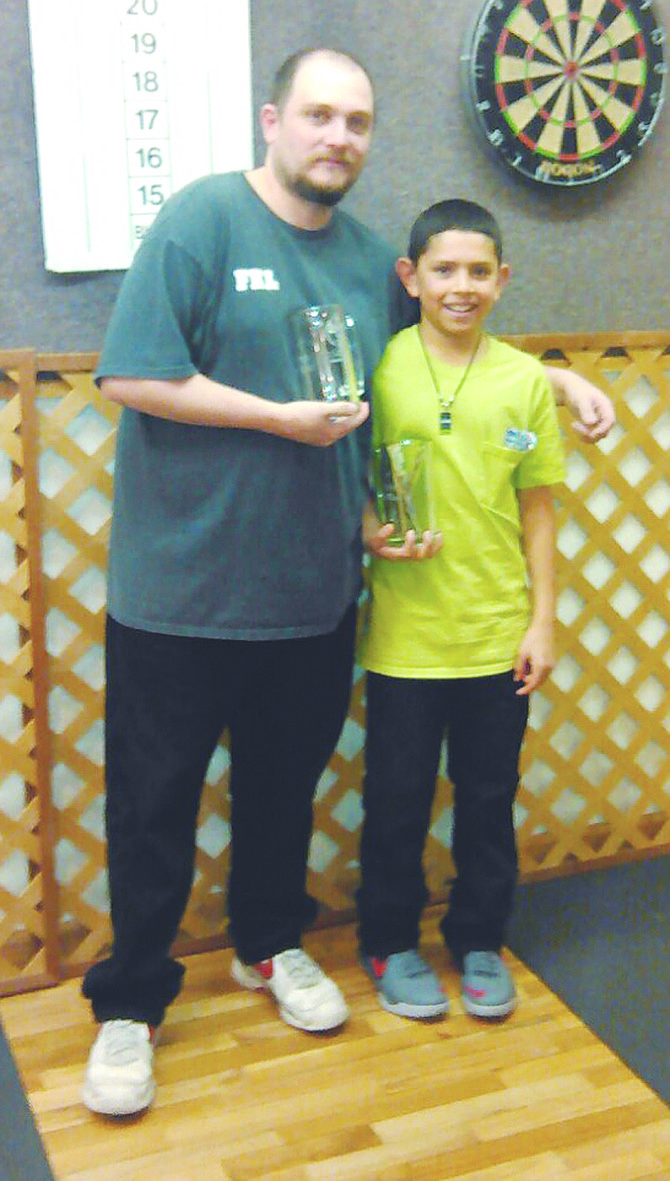 Ten-year-old Eddy Almaguer Jr. is pictured with his uncle, Kevin Luke, after winning first-place honors in the open doubles competition at the Heartbreak Shoot in Milton Freewater, Ore.