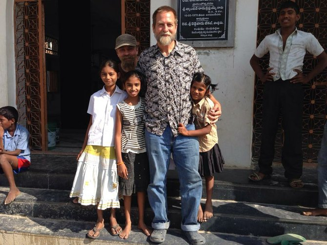 Pastor Brent Ewing is seen with girls from the Indian villages.