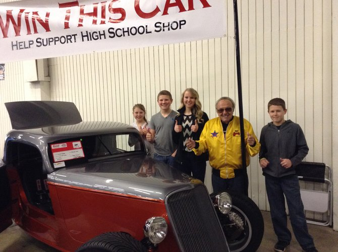 (L-R) Kelly Stubbers, Jake Stubbers, Ashlee Stubbers and Luke Schwartz visit with the famous George Barris (fourth from left) at the Portland Car Show. The Ford Coupe pictured is the car made by the Summit Academy students during their shop class last school year.