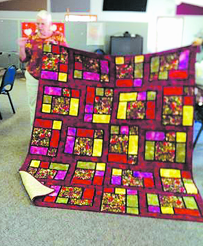 "Sandra Smart of Walla Walla is the creator of this ""Jewel"" quilt, an interpretation of a pattern created by a member of Horizon Quilters Unlimited of Yakima Valley, which will meet on Tuesday, April 8, at Immanuel Lutheran Church in Grandview. A social hour will be held at 9 a.m., with the meeting to follow. A free pattern of the month will be provided, other quilters will share their work and time for sewing of ""American Hero"" quilts to be donated to area hospitals will be allotted. A potluck luncheon will take place to conclude the meeting activities. Anyone interested in quilting may attend."