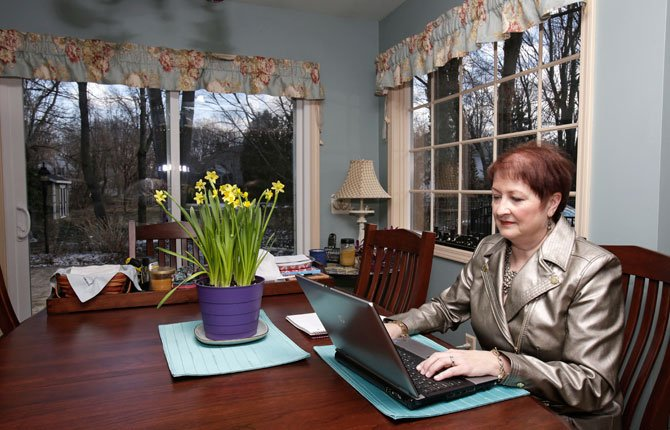 Heather Britton works on her computer at her home in Bay Village, Ohio. New research is boosting hopes that weight-loss surgery can put some patients' diabetes into remission for years and perhaps in some cases, for good. Some patients, like Britton, have passed the five-year mark when some experts consider cure or prolonged remission a possibility. Before the study, she was taking drugs for diabetes, high blood pressure and high cholesterol; she takes none now.