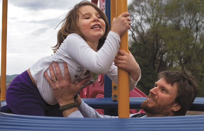 Micaley Toole, 5, gets a helping hand from her dad, C.J., as they play at Thompson Park in The Dalles Tuesday afternoon.