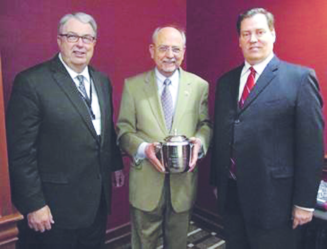 "U.S. Congressman Doc Hastings (center) receives the ""Water Statesman Award"" this past Wednesday. Making the presentation are (at left) Jim Trull, SVID manager and National Water Resources Association water supply task force chairman, and (at right) Tom Myrum, president of the National Water Resources Association."