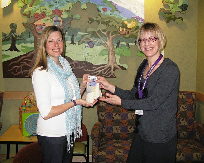 Brynion Berkey, left, hands off her breast milk donation to Jennifer McCauley, lactation consultant at Providence Hood River Memorial Hospital. Berkey, who lives in White Salmon, was the hospital's first donor for its breast milk donation program that began last month.