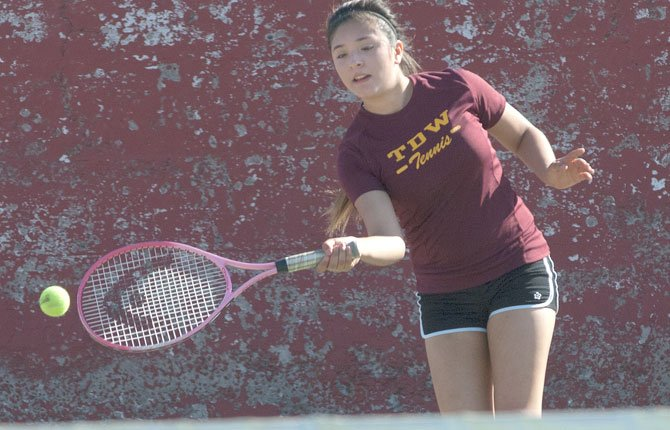 TD girl's tennis player Leslie Luna-Lopez hustles for a volley attempt in a match played last season. Thursday at Cascade High School, Luna-Lopez lost her No. 4 single match 6-1, 6-0 to Andrea Wood, as the Eagle Indians lost this non-league showdown by a 5-3 margin.