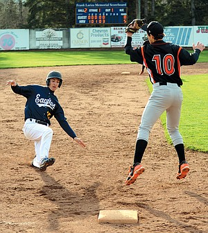 Ryan ward slides into third base in the fifth inning of a 7-0 win Wednesday. Although he dodged the tag, Ward was called out.