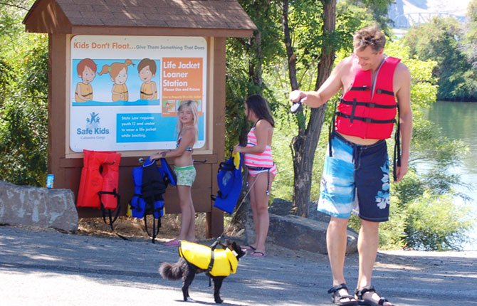 RECREATIONISTS STOP by a Life Jacket Loaner Board in the Columbia Gorge to borrow life vests before enjoying their day.
