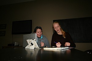 Maddy Graham, HRVHS junior, discusses her April 12 STEM event with math teacher Tina Graves.