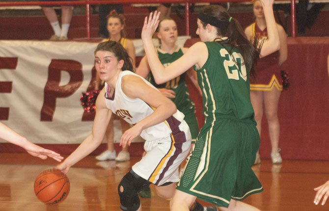 THE DALLES senior Emily Bailey looks for an open teammate in Columbia River Conference girl's basketball action this season. Bailey was one of five players selected as a first-team all-state pick.