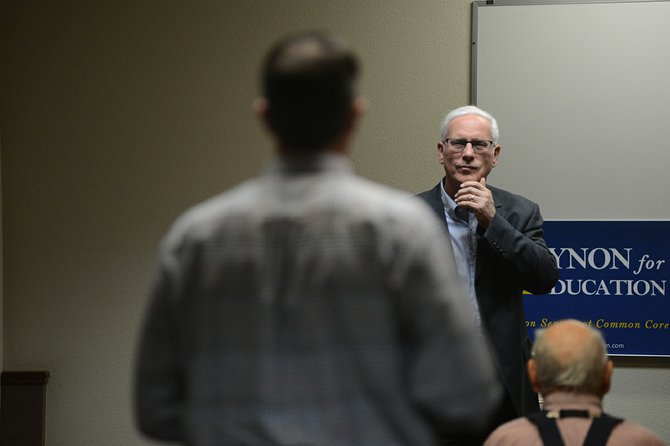 John Eynon (right) of Cottonwood, candidate for State Superintendent of Public Instruction, listens to a questioner at a candidate forum held last Wednesday, April 2, at the Super 8 in Grangeville.