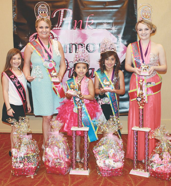 This past Saturday, April 5, several Sunnyside residents competed in the Easter Pageant in Yakima at the Holiday Inn. Pictured are (L-R) Brianna Garza, who assisted with crowning the winners; Karen Hall, named queen in her age group and an award for St. Patrick wear; Audrina Campos, who earned the most points in ages 0-6 and also was the talent winner in her age divisions; Briella Olivarez, who earned the most points for contestants ages 7 and up; and Jenny Hall, who won the queen's title in her age group and was also the talent winner among contestants ages 7 and up.