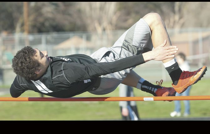 SHERMAN track and field athlete Isaiah Coles leaps over the bar in the high jump event in an event this season in The Dalles. Coles had a height of 5-feet-6 inches at the Estacada Small School Invitational for first place.