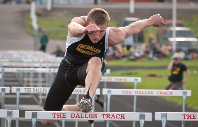 THE DALLES senior Zach Nerdin competes in the 300-meter hurdles during Tuesday's meet with Pendleton at the Wahtonka campus. Nerdin secured first place with a final time of 16.32 seconds, just .08 off his personal best.