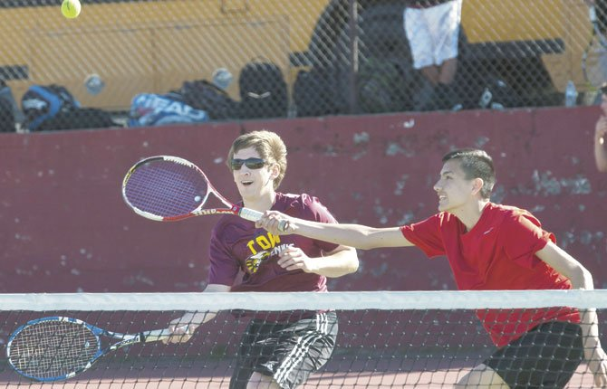 THE DALLES No. 2 doubles team of Daniel Spurr, left, and Daniel Santillan compete in a matchup against Hermiston Wednesday in The Dalles. They lost 6-1, 6-1 and the team suffered an 8-0 setback.