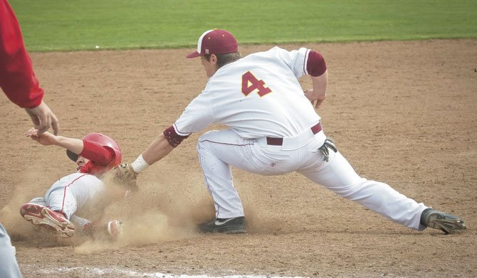 THE DALLES senior third baseman Nolan McCall (4) tags out a base runner for the second out in Friday's baseball game in The Dalles. The No. 4-ranked Eagle Indians broke open a 2-0 lead with nine runs in the third frame to secure their eighth-straight victory in a 12-1 mercy-ruled manner over 6A Lincoln.