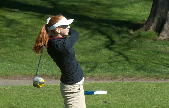 THE DALLES golfer Jennifer Bonham follows through on a tee shot while playing at the Eagle Indian Invitational at The Dalles Country Club. Bonham and her teammates ended up in third place Monday in Pendleton at the Wildhorse Invitational Tournament.