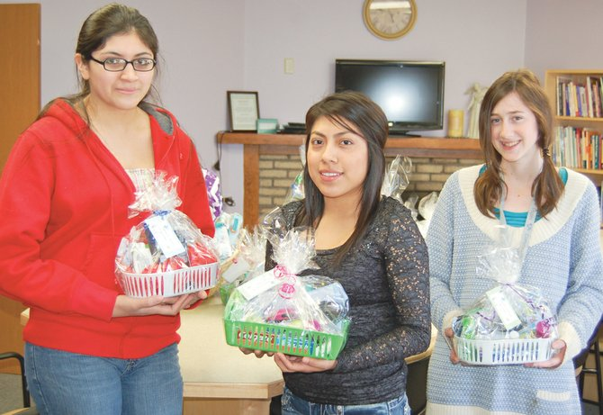 YV-Tech nursing students Thalya Bibriesca, Susy Hernandez and Candy Wisdom delivered a donation that included Easter baskets and other care items to the Wiley House in Sunnyside last Friday. Students in the nursing program regularly hold fundraisers as part of their leadership training. The money raised is used to support programs around the county, including Wiley House.