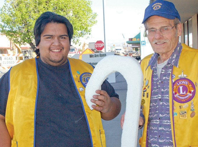 "Sunnyside Lions Club members Sam Ortega (L) and Delbert Stone say Sunnyside Lions Club will be in front of the Sunnyside Safeway store on Friday and Saturday, April 18 and 19, promoting White Cane Days.  ""Your donations are used to assist individuals who are in need of vision exams, glasses and help with other vision issues,"" said Ortega, co-chairman of this year's fundraiser. ""Help us give visually-impaired people sight,"" he added."
