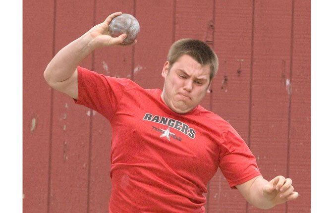 DUFUR'S Austin Olson winds up for his shotput attempt in track and field. Saturday at the Meet of Champions in Salem, Olson had a pair of top-20 finishes in the shotput and discus events.