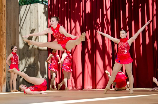 Lorrie Fraley-Wilson Dance Studios dancers perform on stage at Disneyland.