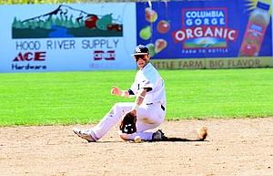 Skyler hunter makes a back-handed snag at shortstop to keep a Bend High batter off-base in Saturday's doubleheader at Traner Field.