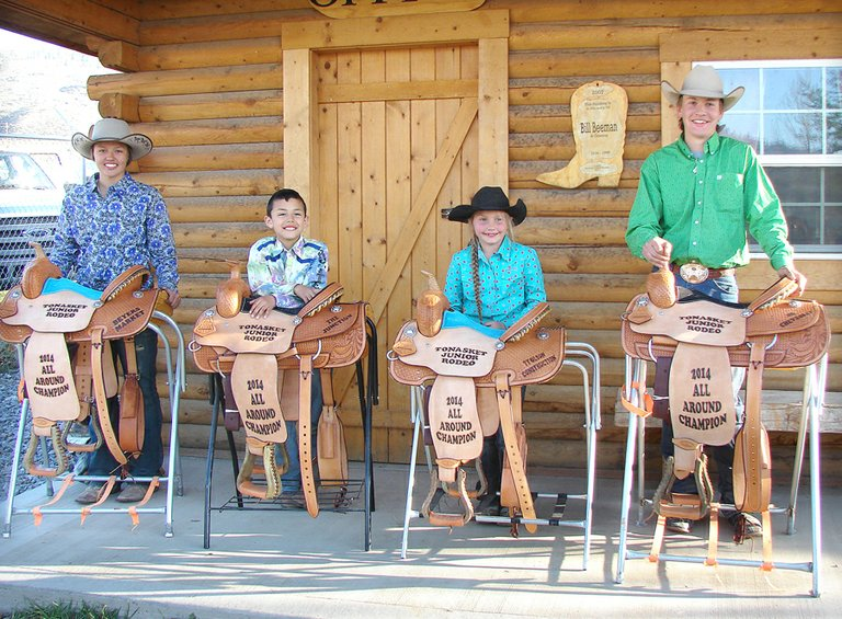 Saddle winners at the annual Tonasket Junior Rodeo performed April 19-20 include, from left, Kaelyn Marchand, Bryson Butterfly, Quincy Downey and Wade Bruemmer.