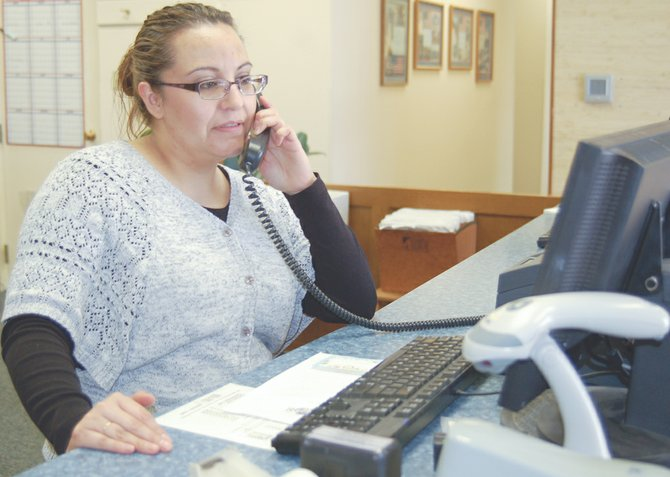 As the friendly face of Sunnyside city hall, Gina Chavez is the person most likely to answer calls and accept payment for bills.