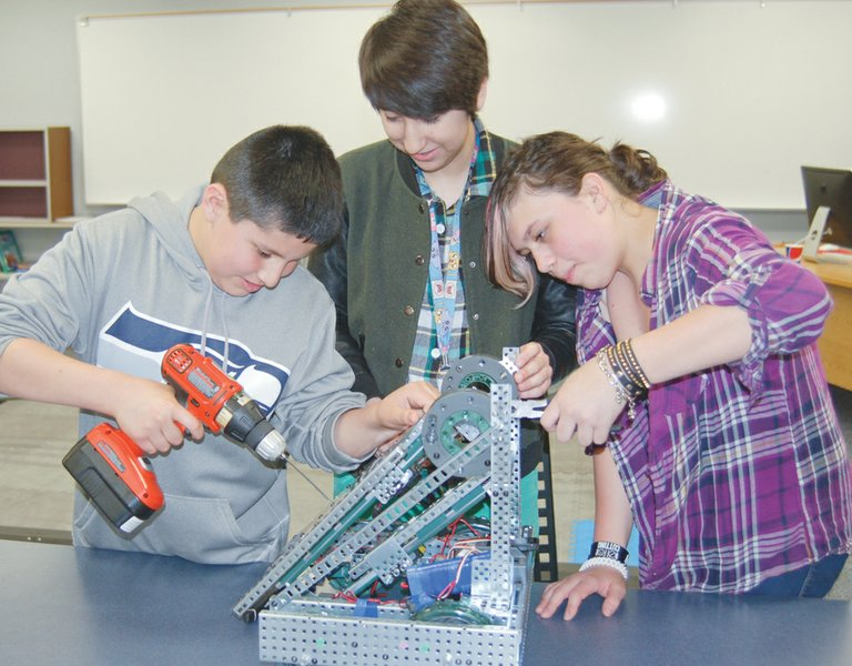 The Robo-Nerds and a Pedal robotics team from Harrison Middle School, made up of (L-R) Ben Rios, Margarita Romero and Andrea Barcenas, will be competing in the VEX Robotics World Championships at the Anaheim Convention Center on Wednesday, April 23, in California.