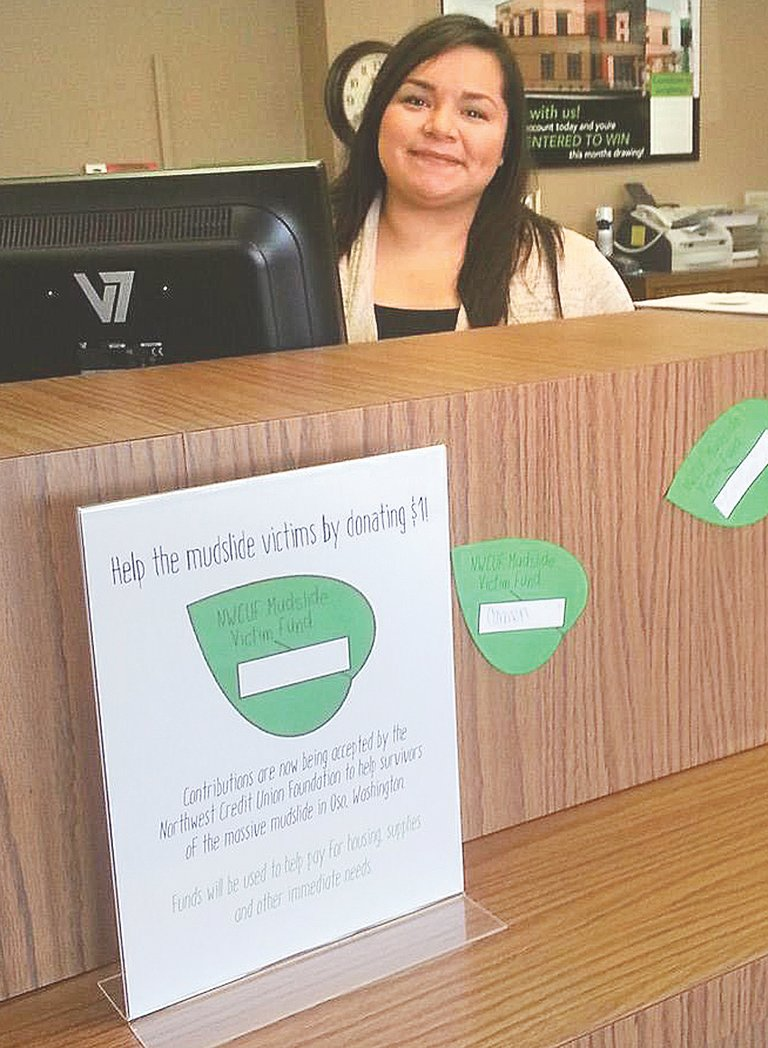 Nancy Aguirre at the Sunnyside branch of LVCU helped raise money for landslide victims by asking members to make donations.