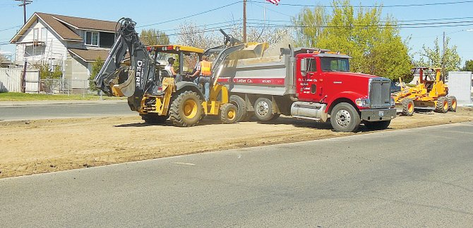A crew from O.L. Luther remove old curbing and asphalt in preparation for work at the Jerry Taylor Veterans Plaza in Sunnyside.