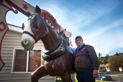 Mike Lakowski poses next to the Budweiser horse that is prominently featured in his The Dalles yard.