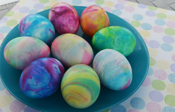 "A Thrifty Mom shows the use of shaving cream and liquid food coloring to dye hard-boiled eggs which gives them a tie-dyed effect. It's a tactile project most kids will enjoy. ""Using shaving cream our kids thought it smelled great and had fun at every part of the project!"" writes Sarah Barrand at her A Thrifty Mom blog."