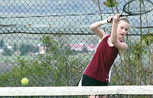 THE DALLES freshman tennis player Kiana Pielli hammers home a cross-court shot in her doubles match Tuesday in The Dalles. Pielli and doubles partner, Johanna Wilson, secured a 6-3, 6-3 winner as part of a 6-2 win over Hood River Valley. That league win is the first for the program in three years.