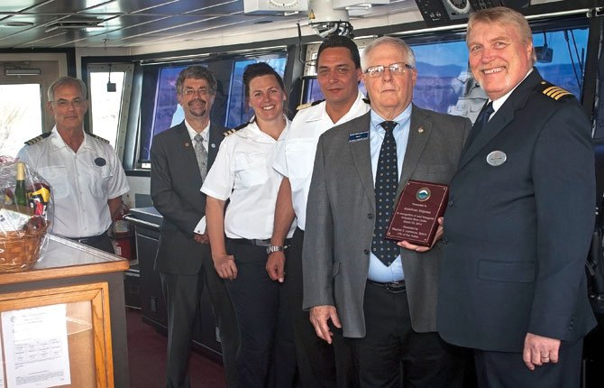 AMERICAN EMPRESS Capt. Rob Nordstrom, front right,  is shown with a plaque of appreciation delivered April 15 by The Dalles Mayor Steve Lawrence to the pilothouse, during an informal ceremony attended by Bernhard Schindlauer, hotel manager, center, Chief Mate Andrea Mickelson, The Dalles City Councilor Dan Spatz and Staff Capt. Mike Chance.