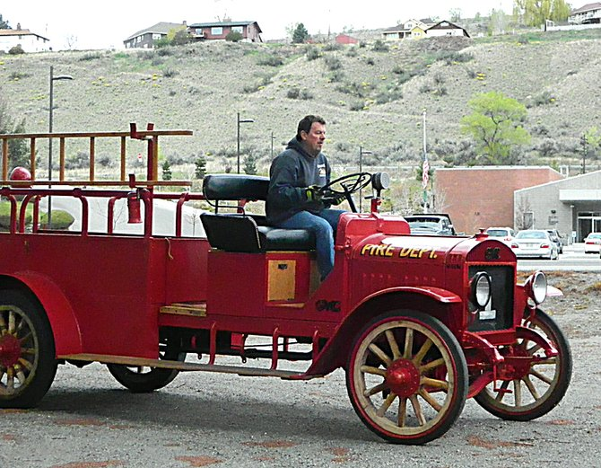 Omak Assistant Fire Chief Dan Wood prepares to drive the department's engine No. 1 from the Okanogan Fire Hall Museum to Omak on Thursday morning for the department's Saturday centennial celebration. An open house will run from noon to 4 p.m. Saturday at the Omak Fire Hall, 16 N. Ash St.